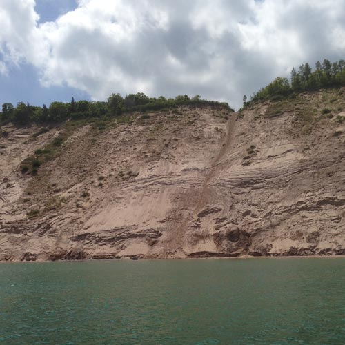 The steep sandy slope of the Log Slide, as viewed from Lake Superior.