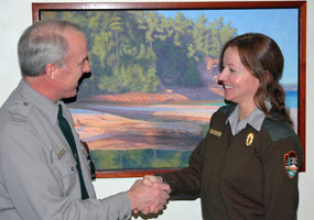 Superintendent Jim Northup welcomes Meg Hahr, Chief of Science and Natural Resources, to the Pictured Rocks National Lakeshore staff.