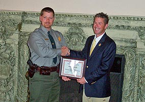 Michael Teranes receives an NPS Search and Rescue Award from Chief Ranger Tim Colyer.