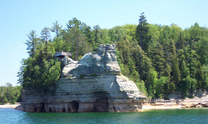 Miners Castle as viewed from Lake Superior.  Note the visitors on the viewing platform.