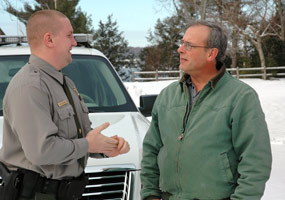 Park Ranger Brad Heyrman with a local resident.
