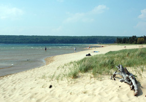 A hazy morning at Sand Point Beach as peaceful waves from Lake Superior wash ashore.