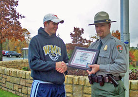 Scott Sherrod receives an NPS search and rescue award from PRNL Chief Ranger Tim Colyer.