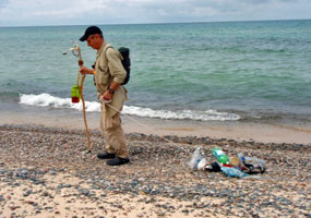 This Adopt a Trail volunteer collects litter near Pine Bluff along Lake Superior. A beautiful place to volunteer!