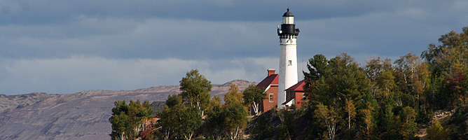 Au Sable Light Station and Grand Sable Dunes as viewed from Lake Superior.