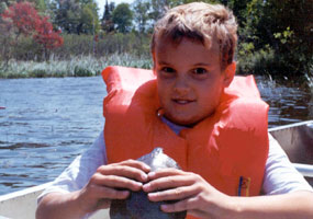 This boy caught a turtle while canoeing at Pictured Rocks National Lakeshore.  He released the turtle back into the lake shortly after the photo was taken.