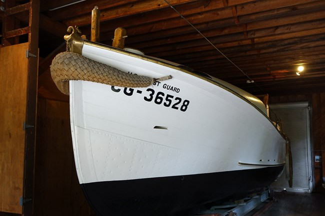 Authentic lifeboat in the boathouse on Sand Point
