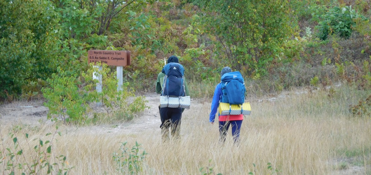 Two backpackers on the North Country Trail near the Au Sable Lightstation