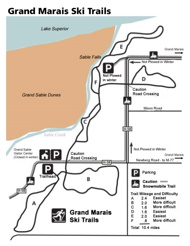 Grand Marais cross country ski trail map showing trails A, B, C, D, E, and F. Also includes parking areas, the snowmobile trail that runs along and on county road H-58, and where Lake Superior, the Grand Sable Dunes, and the town of Grand Marais are in re