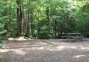 A campsite at Hurricane River Campground waits patiently for visitors.