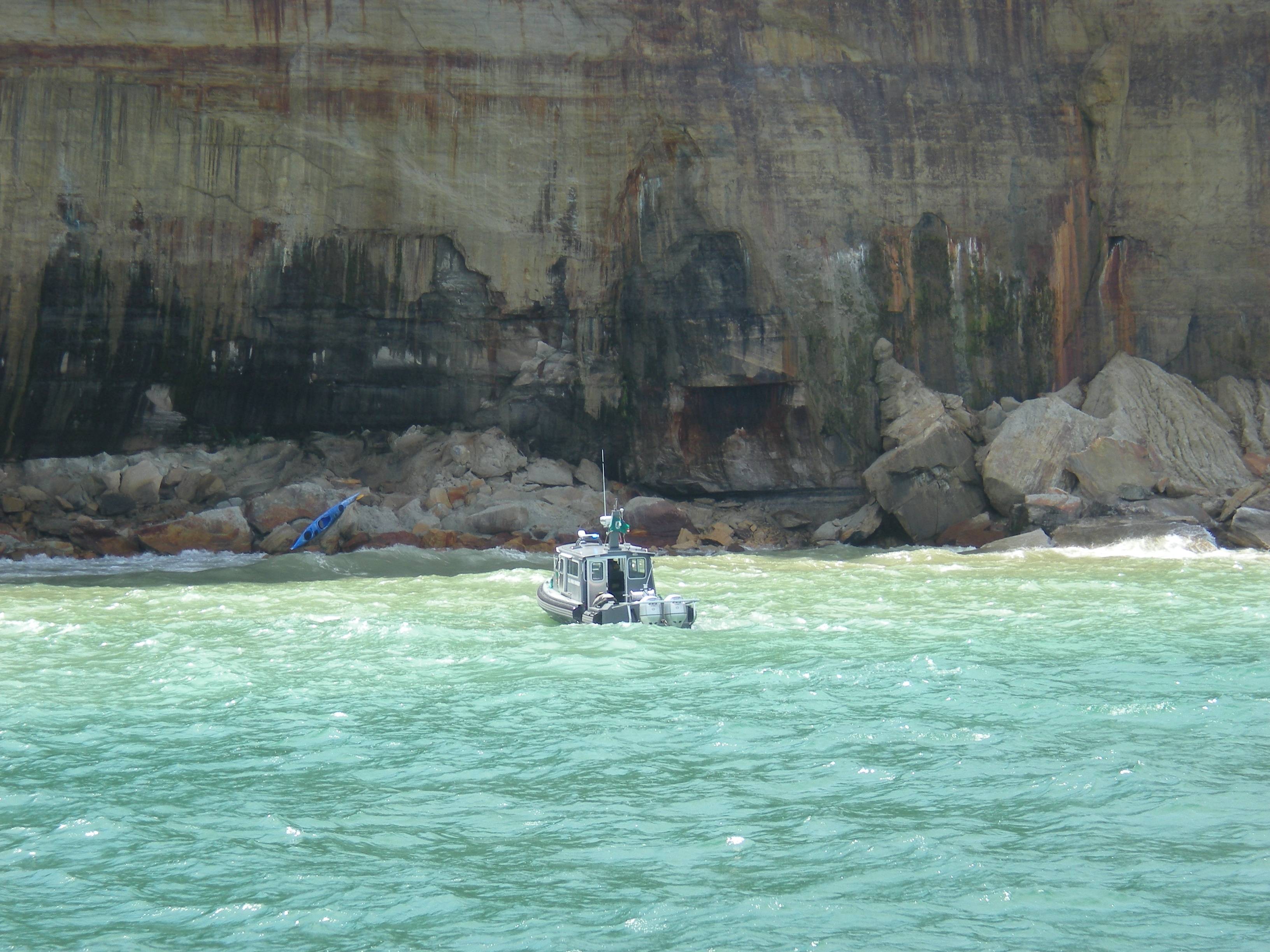 Kayak rescue along Pictured Rocks cliffs