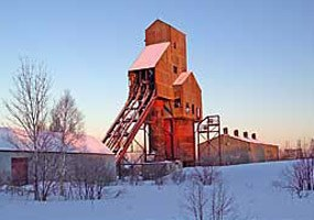 Evening light from the winter sunset illuminates the Osceola Number 13 copper mine shafthouse.