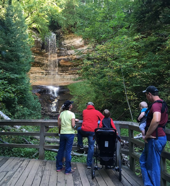 Family visiting Munising Falls