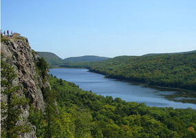 The beautiful Lake of the Clouds is surrounded by towering hills with lush green northwoods vegetation.