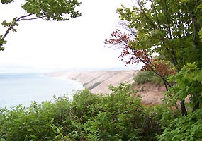 The Grand Sable Dunes tower over Lake Superior from this photo taken at the Log Slide.