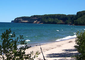 The white sands of Miners Beach stretch a half-mile just east of Miners Castle along the beautiful shores of Lake Superior.