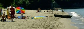 Sunbathers and other visitors at Miners Beach in the summer