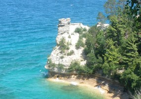 Miners Castle, the most familiar feature of the Pictured Rocks cliffs, seen from the overlook. It is easily accessible by automobile.