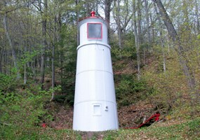 With its companion front range light, the Munising Rear Range Light helps guide mariners into Munising Bay.