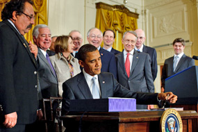 President Obama signs the Omnibus Public Lands Management Act of 2009 into law on March 30 at the White House. Also pictured from left to right: Rep. Raúl Grijalva (D-AZ), Rep. Nick Rahall (D-WV), Speaker of the House Nancy Pelosi (D-CA), Rep. Buck McKeon (R-CA), Secretary of the Interior Ken Salazar, Senate Majority Leader Harry Reid (D-NV), Senator Ron Wyden (D-OR), and Senator Robert Bennett (R-UT) (White House Photo, 3/30/09, Chuck Kennedy)