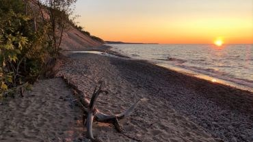 Sunset along Sable Falls Beach overlooking Lake Superior.