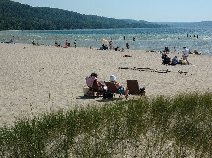 People enjoying Sand Point Beach
