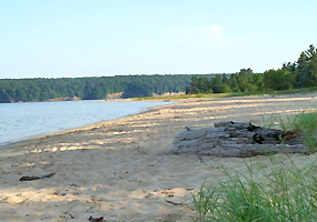 Sand Point beach on a peaceful July morning, just waiting for the afternoon heat wave, swimmers, waders, kayakers, and picnickers.