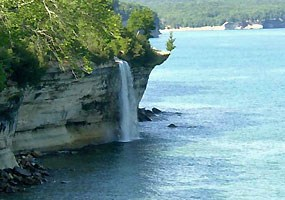 Spray Falls plunges over the Pictured Rocks directly into Lake Superior.
