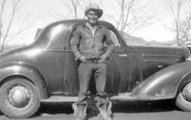 Wilson Mayo standing in front of car