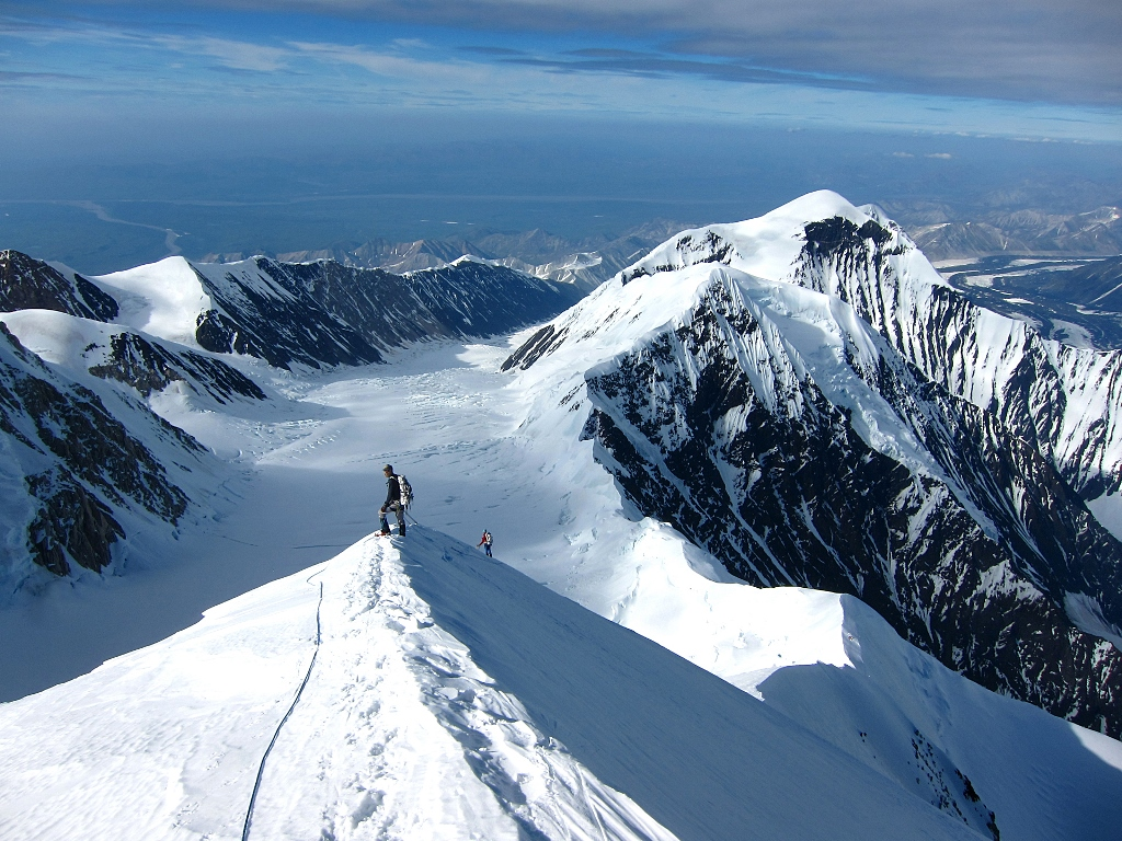 Climbers on Karstens Ridge looking out towards of the tundra north of Denali