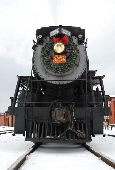 Steam train decorated with a wreath