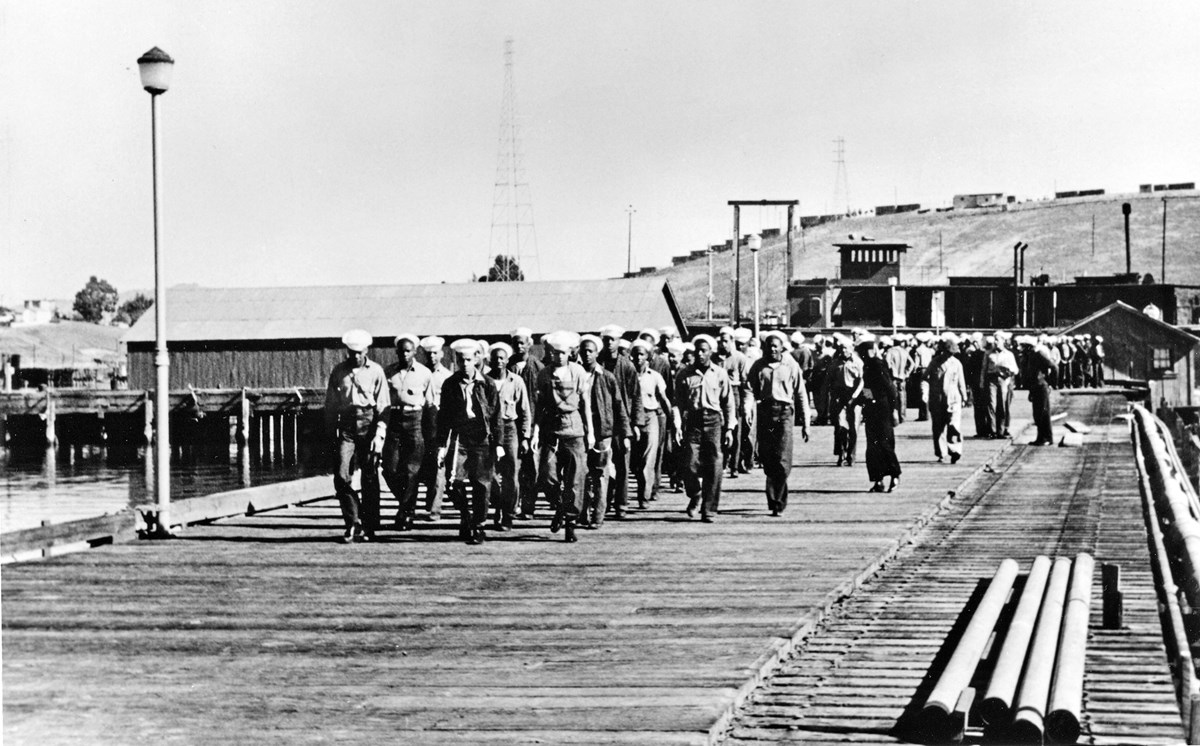 Historic photo of African American sailors marching on the pier at Port Chicago.