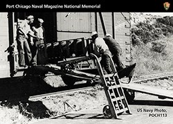 Trading Card showing African American male loading ammunition onto a train car.