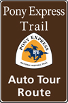 Brown highway auto tour route sign with Pony Express logo and text: Pony Express Trail Auto Tour Route.
