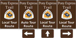 Four brown tall rectangular highway signs with white text saying: Pony Express Trail Auto Tour Route and a triangular logo with orange and white and a blue pony rider.