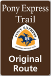 Brown tall rectanglular highway sign with white words: Pony Express Trail Original Route and white, orange and blue trail logo of rider.