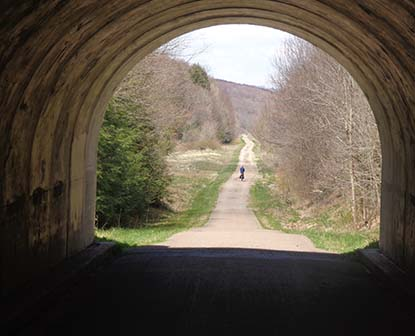 View inside of a tunnel as a bike travels in the distance