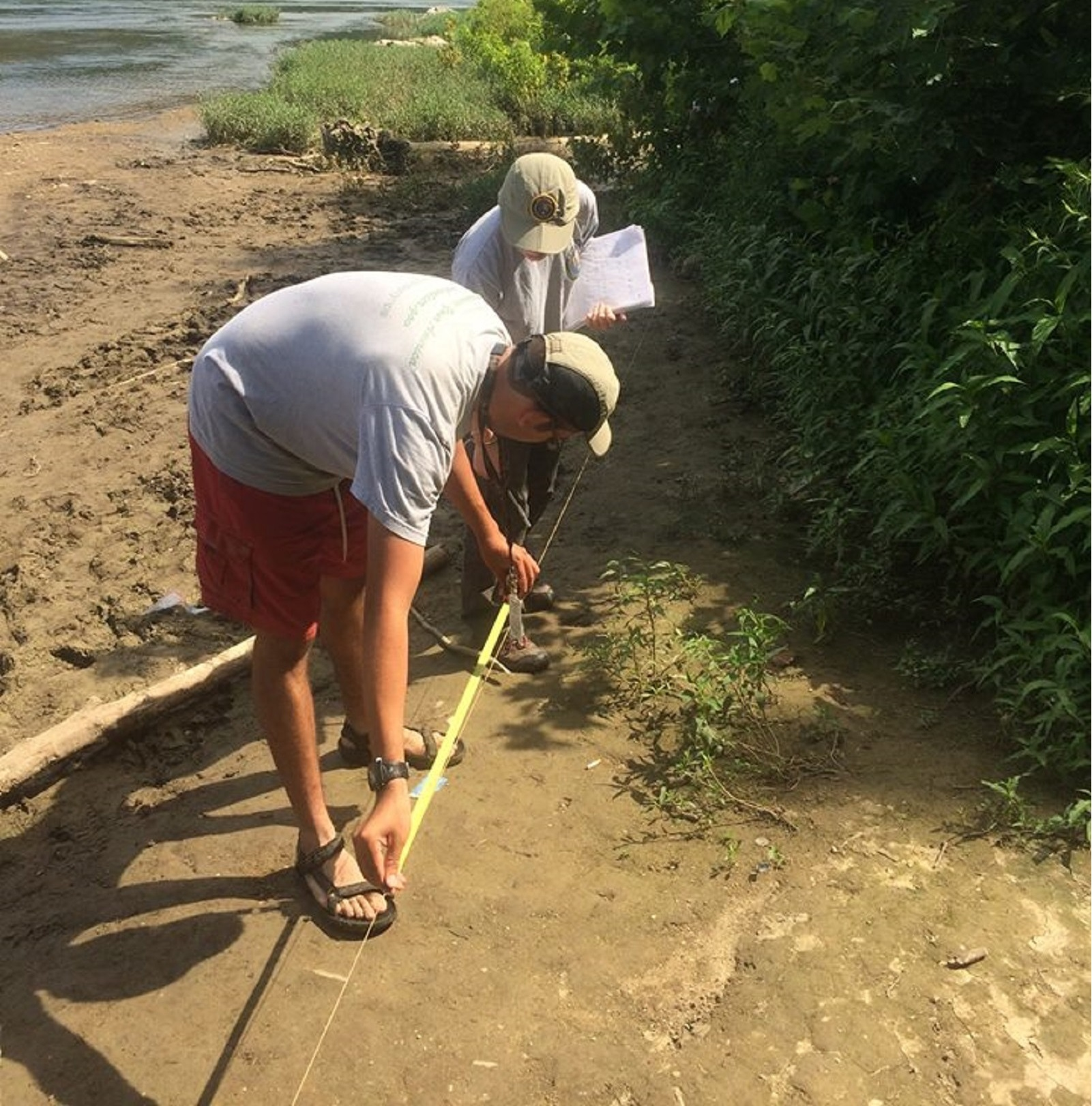 Volunteers work along the shores of the Potomac River.