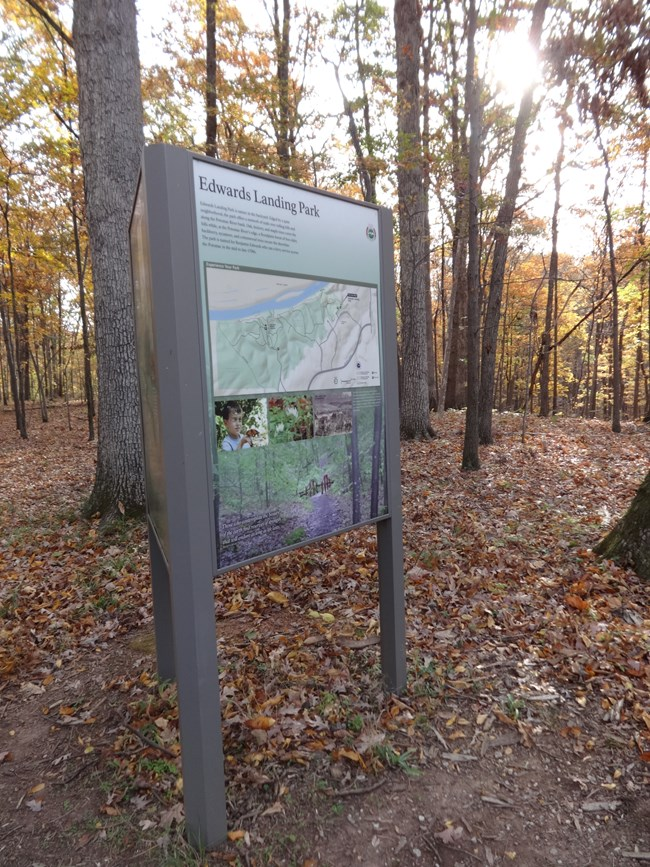 An upright panel showing information about the Potomac Heritage Trail