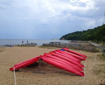 Kayaks ready to be rented at Westmoreland State Park along the beach