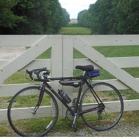 Bicycle resting against fence along the PHT network