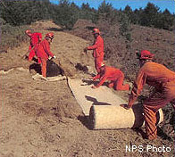 Rehabilitation team rolling curlex blankets for slope stabilization after the 1995 Vision Fire.