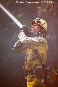 Firefighter with hose attempting to contain the 1995 Vision Fire.