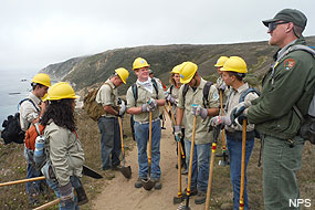 YCC safety briefing along the bluffs of the Pacific Coast before continuing on with the day's work.