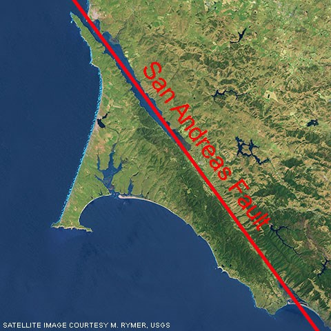 A color satellite photo of Point Reyes with a red line marking the San Andreas Fault.