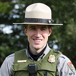 Ranger Michael wearing his National Park Service uniform and flat hat.
