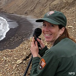 Point Reyes Social Media Team member Sarah watching elephant seals through a spotting scope.