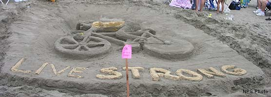 2005 Sand Sculpture Contest: Adults' Group 1st Place: Entry #18: Live Strong, by the LeCoopson Family