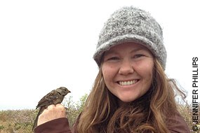 Jennifer Phillips with a white-crowned sparrow. © Jennifer Phillips.