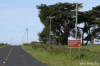 "A sign reading ""North District Operations Center"" alongside of a road."